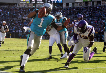 CHARLOTTE, NC - OCTOBER 30: Cam Newton #1 of the Carolina Panthers carries the ball against the Minnesota Vikings at Bank of America Stadium on October 30, 2011 in Charlotte, North Carolina. (Photo by Scott Cunningham/Getty Images)