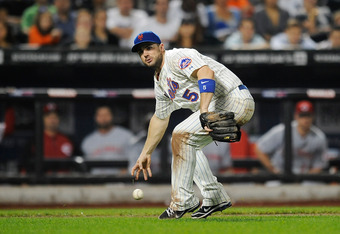 NEW YORK, NY - SEPTEMBER 26:  David Wright #5 of the New York Mets tries to field a sacrifice bunt hit by Dave Sappelt #17 of the Cincinnati Reds in the sixth inning during a game at Citi Field on September 26, 2011 in the Flushing neighborhood of the Que