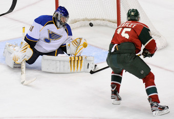ST PAUL, MN - NOVEMBER 5: Jaroslav Halak #41 of the St. Louis Blues watches the shot by Dany Heatley #15 of the Minnesota Wild get past him in the second period on November 5, 2011 at Xcel Energy Center in Minneapolis, Minnesota. The Wild defeated the Blu