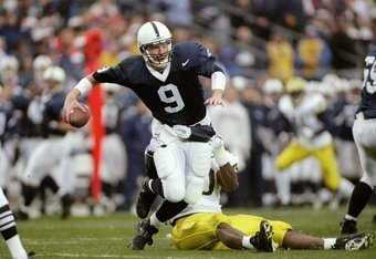8 Nov 1997: Quarterback Mike McQueary of the Penn State Nittany Lions gets tackled during a game against the Michigan Wolverines at Beaver Stadium in State College, Pennsylvania. Michigan won the game, 34-10.