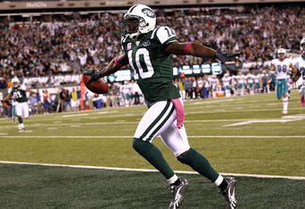 EAST RUTHERFORD, NJ - OCTOBER 17:  Santonio Holmes #10 of the New York Jets runs in for a touchdown during a win over the Miami Dolphins  at MetLife Stadium on October 17, 2011 in East Rutherford, New Jersey.  (Photo by Jeff Zelevansky/Getty Images)