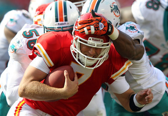 KANSAS CITY, MO - NOVEMBER 06:  Quarterback Matt Cassel #7 of the Kansas City Chiefs is sacked by Kevin Burnett #56 and Cameron Wake #91 of of the Miami Dolphins during the game on November 6, 2011 at Arrowhead Stadium in Kansas City, Missouri.  (Photo by