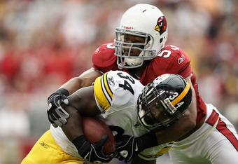 GLENDALE, AZ - OCTOBER 23:  Runningback Rashard Mendenhall #34 the Pittsburgh Steelers is tackled as he carries the football against the Arizona Cardinals during the NFL game at the University of Phoenix Stadium on October 23, 2011 in Glendale, Arizona. T