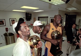 A young Kobe celebrates with then teammate Shaq and Magic Johnson