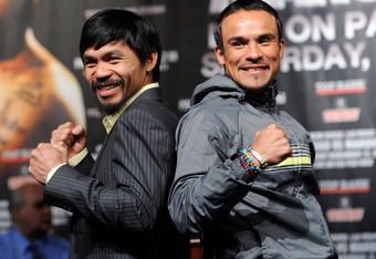 LAS VEGAS, NV - NOVEMBER 09:  Boxers Manny Pacquiao (L) and Juan Manuel Marquez pose during the final news conference for their bout at the MGM Grand Hotel/Casino November 9, 2011 in Las Vegas, Nevada. Pacquiao will defend his WBO welterweight title again