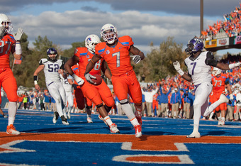BOISE, ID - NOVEMBER 12:  D.J. Harper #7 of the Boise State Broncos carries for a touchdown against the TCU Horned Frogs at Bronco Stadium on November 12, 2011 in Boise, Idaho.  (Photo by Otto Kitsinger III/Getty Images)