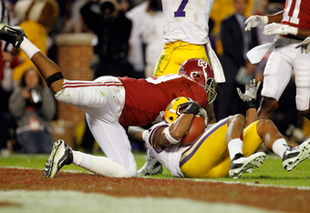 TUSCALOOSA, AL - NOVEMBER 05:  Eric Reid #1 of the LSU Tigers makes a catch over Michael Williams #89 of the Alabama Crimson Tide for an interception during the second half of the game at Bryant-Denny Stadium on November 5, 2011 in Tuscaloosa, Alabama.  (