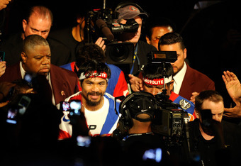 LAS VEGAS, NV - NOVEMBER 12:  Manny Pacquiao walks to enter the ring to take on Juan Manuel Marquez in the WBO world welterweight title fight at the MGM Grand Garden Arena on November 12, 2011 in Las Vegas, Nevada.  (Photo by Ethan Miller/Getty Images)