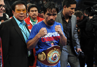 LAS VEGAS, NV - NOVEMBER 12:  Manny Pacquiao celebrates his majority decision victory against Juan Manuel Marquez in the WBO world welterweight title fight at the MGM Grand Garden Arena on November 12, 2011 in Las Vegas, Nevada.  (Photo by Harry How/Getty