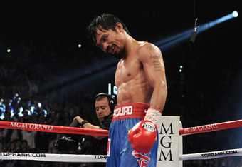 LAS VEGAS, NV - NOVEMBER 12:  Manny Pacquiao reacts after the 12th round before it is announced that he won by majority decision against Juan Manuel Marquez in the WBO world welterweight title fight at the MGM Grand Garden Arena on November 12, 2011 in La