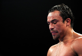 LAS VEGAS, NV - NOVEMBER 12:  Juan Manuel Marquez reacts in the ring as he takes on Manny Pacquiao during the WBO world welterweight title fight at the MGM Grand Garden Arena on November 12, 2011 in Las Vegas, Nevada.  (Photo by Harry How/Getty Images)