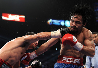 LAS VEGAS, NV - NOVEMBER 12:  (L-R) Juan Manuel Marquez throws a right to the head of Manny Pacquiao during the WBO world welterweight title fight at the MGM Grand Garden Arena on November 12, 2011 in Las Vegas, Nevada.  (Photo by Harry How/Getty Images)