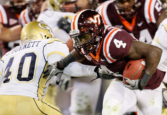 ATLANTA, GA - NOVEMBER 10:  David Wilson #4 of the Virginia Tech Hokies breaks a tackle by Julian Burnett #40 of the Georgia Tech Yellow Jackets at Bobby Dodd Stadium on November 10, 2011 in Atlanta, Georgia.  (Photo by Kevin C. Cox/Getty Images)