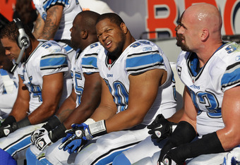 DENVER, CO - OCTOBER 30:  Ndamukong Suh #90 of the Detroit Lions and the defensive line sit onmthe bench as they prepare to face the Denver Broncos Sports Authority at Invesco Field at Mile High on October 30, 2011 in Denver, Colorado.  (Photo by Doug Pen