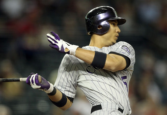 PHOENIX, AZ - AUGUST 30:  Carlos Gonzalez #5 of the Colorado Rockies bats against the Arizona Diamondbacks during the Major League Baseball game at Chase Field on August 30, 2011 in Phoenix, Arizona.  The Diamondbacks defeated the Rockies 9-4. (Photo by C