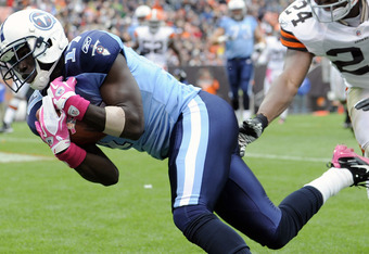 CLEVELAND, OH - OCTOBER 2: Wide receiver Damian Williams #17 of the Tennessee Titans catches a touchdown pass over cornerback  Sheldon Brown #24 of the Cleveland Browns during the second quarter at Cleveland Browns Stadium on October 2, 2011 in Cleveland,