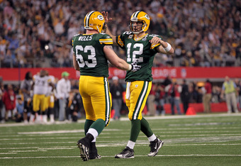 ARLINGTON, TX - FEBRUARY 06:  Aaron Rodgers #12 and Scott Wells #63 of the Green Bay Packers celebrate after an 8 yard touchdown in the fourth quarter against the Pittsburgh Steelers during Super Bowl XLV at Cowboys Stadium on February 6, 2011 in Arlingto
