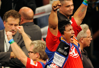 Freddie Roach and Buboy Fernandez celebrate the majority decision.  During the fight, Pacquiao's corner was imploring him for more action and seemed to be equal parts Roach, Fernandez, and Alex Ariza providing instruction.