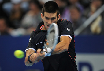 BASEL, SWITZERLAND - NOVEMBER 05:  Novak Djokovic of Serbia hits a backhand during his semi final match against Kei Nishikori of Japan during day six of the Swiss Indoors at St Jakobshalle on November 5, 2011 in Basel, Switzerland.  (Photo by Harold Cunni