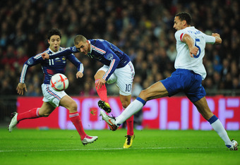 LONDON, ENGLAND - NOVEMBER 17:  Karim Benzema of France shoots past Rio Ferdinand of England during the international friendly match between England and France at Wembley Stadium on November 17, 2010 in London, England.  (Photo by Shaun Botterill/Getty Im