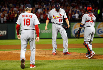ARLINGTON, TX - OCTOBER 24: Pitching coach Dave Duncan (L) and Yadier Molina #4 (R) visit Chris Carpenter #29 of the St. Louis Cardinals on the mound during Game Five of the MLB World Series against the Texas Rangers at Rangers Ballpark in Arlington on Oc
