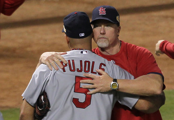 ARLINGTON, TX - OCTOBER 22:  Albert Pujols #5 and batting coach Mark McGuire celebrate after defeating the Texas Rangers 16-7 in Game Three of the MLB World Series at Rangers Ballpark in Arlington on October 22, 2011 in Arlington, Texas.  (Photo by Ezra S