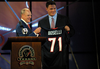 18 Feb 2002: Team owner Bob McNair presents the jersey to Tony Boselli during the Texans Expension Draft at George R. Brown Convention Center in Houston, Texas. Boselli was aquired from the Jacksonville Jaguars. DIGITAL IMAGE. Mandatory Credit: Ronald Mar