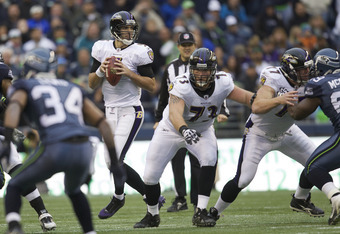 SEATTLE, WA - NOVEMBER 13: Quarterback Joe Flacco #5 of the Baltimore Ravens drops back to pass during a game against the Seattle Seahawks at CenturyLink Field on November 13, 2011 in Seattle, Washington. The Seahawks won the game 22-17. (Photo by Stephen