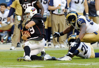 GLENDALE, AZ - NOVEMBER 06:  John Skelton #19 of the Arizona Cardinals slides for a first down against the St Louis Rams at University of Phoenix Stadium on November 6, 2011 in Glendale, Arizona.  (Photo by Norm Hall/Getty Images)