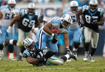 CHARLOTTE, NC - NOVEMBER 13:   James Anderson #50 of the Carolina Panthers tackles  Javon Ringer #21 of the Tennessee Titans during their game at Bank of America Stadium on November 13, 2011 in Charlotte, North Carolina.  (Photo by Streeter Lecka/Getty Im