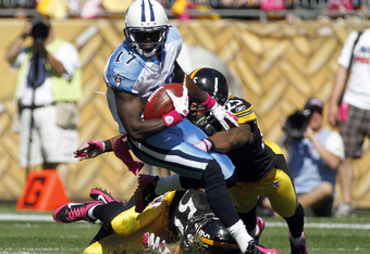 PITTSBURGH, PA - OCTOBER 9:   Ryan Clark #25 of the Pittsburgh Steelers tackles  Damian Williams #17 of the Tennessee Titans during the game on October 9, 2011 at Heinz Field in Pittsburgh, Pennsylvania.  (Photo by Justin K. Aller/Getty Images)