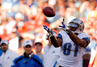 DENVER, CO - OCTOBER 30:  Wide receiver Calvin Johnson #81 of the Detroit Lions makes a reception on his way to scoring a 56-yard touchdown during the third quarter against the Denver Broncos at Sports Authority Field at Mile High on October 30, 2011 in D
