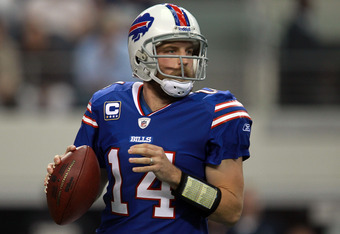 ARLINGTON, TX - NOVEMBER 13:  Ryan Fitzpatrick #14 of the Buffalo Bills throws against the Dallas Cowboys at Cowboys Stadium on November 13, 2011 in Arlington, Texas.  (Photo by Ronald Martinez/Getty Images)