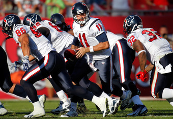 TAMPA, FL - NOVEMBER 13:  Quarterback Matt Leinhart #11 of the Houston Texans hands the ball off against the Tampa Bay Buccaneers during the game at Raymond James Stadium on November 13, 2011 in Tampa, Florida.  (Photo by J. Meric/Getty Images)