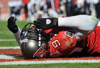 TAMPA, FL - NOVEMBER 13:  Defensive end George Johnson #97 of the Tampa Bay Buccaneers falls with an injry in the end zone against the Houston Texans November 13, 2011 at Raymond James Stadium in Tampa, Florida. (Johnson left the game.  Photo by Al Messer