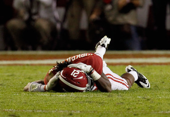TUSCALOOSA, AL - NOVEMBER 05:  Dre Kirkpatrick #21 of the Alabama Crimson Tide is hurt after a punt during the game against the LSU Tigers at Bryant-Denny Stadium on November 5, 2011 in Tuscaloosa, Alabama.  (Photo by Kevin C. Cox/Getty Images)