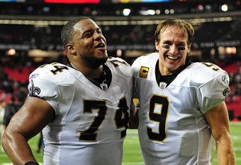 ATLANTA, GA - NOVEMBER 13: Drew Brees #9 of the New Orleans Saints celebrates with Jermon Bushrod #74 after the game against the Atlanta Falcons at the Georgia Dome on November 13, 2011 in Atlanta, Georgia. (Photo by Scott Cunningham/Getty Images)