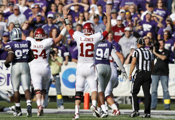 MANHATTAN, KS - OCTOBER 29:   Quarterback Landry Jones #12 of the Oklahoma Sooners celebrates an 18-yard touchdown pass to teammate Jaz Reynolds #16 in the second quarter during a game against the Kansas State Wildcats at Bill Snyder Family Stadium on Oct