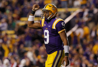 BATON ROUGE, LA - NOVEMBER 12:  Jordan Jefferson #9 of the Louisiana State University Tigers celebrates after throwing a touchdown pass against the Western Kentucky Hilltoppers at Tiger Stadium on November 12, 2011 in Baton Rouge, Louisiana.  The Tigers d