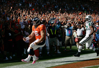 DENVER - OCTOBER 17:  Quarterback Tim Tebow #15 of the Denver Broncos celebrates his touchdown run in the first half against the New York Jets at INVESCO Field at Mile High on October 17, 2010 in Denver, Colorado.  (Photo by Justin Edmonds/Getty Images)