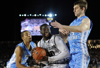 CORONADO, CA - NOVEMBER 11:  Draymond Green #10 of the Michigan State Spartans goes in for a shot in front of Tyler Zeller #44 and Kendall Marshall #5 of the North Carolina Tar Heels during the Quicken Loans Carrier Classic on board the USS Carl Vinson on