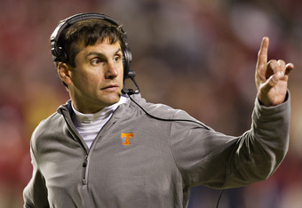 FAYETTEVILLE, AR - NOVEMBER 12:   Head Coach Derek Dooley of the Tennessee Volunteers signals to the sidelines during a game against the Arkansas Razorbacks at Donald W. Reynolds Stadium Stadium on November 12, 2011 in Fayetteville, Arkansas.  The Razorba
