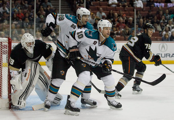 ANAHEIM, CA - SEPTEMBER 21:  (L-R) Goaltender Jeff Deslauries #43 of the Anaheim Ducks defends his net, as Andrew Murray #28 and Brad Winchester #10 of the San Jose Sharks set up a screen at Honda Center on September 21, 2011 in Anaheim, California.  (Pho