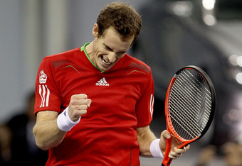 SHANGHAI, CHINA - OCTOBER 16:  Andy Murray of Great Britain celebrates match point against David Ferrer of Spain during the final of the Shanghai Rolex Masters at the Qi Zhong Tennis Center on October 16, 2011 in Shanghai, China.  (Photo by Matthew Stockm
