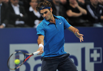 BASEL, SWITZERLAND - NOVEMBER 06:  Roger Federer of Switzerland in action during the final against Kei Nishikori of Japan on day seven of the Swiss Indoors at St Jakobshalle on November 6, 2011 in Basel, Switzerland.  (Photo by Harold Cunningham/Getty Ima