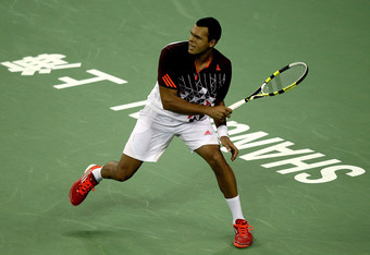 SHANGHAI, CHINA - OCTOBER 12:  Jo-Wilfried Tsonga of France returns a shot to Kei Nishikori of Japan during the Shanghai Rolex Masters at the Qi Zhong Tennis Center on October 12, 2011 in Shanghai, China.  (Photo by Matthew Stockman/Getty Images)