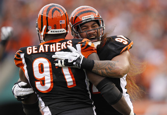CINCINNATI, OH - NOVEMBER 13: Domata Peko #94 and Robert Geathers #91 of the Cincinnati Bengals celebrate during the game against the Pittsburgh Steelers at Paul Brown Stadium on November 13, 2011 in Cincinnati, Ohio. The Steelers won 24-17. (Photo by Joe