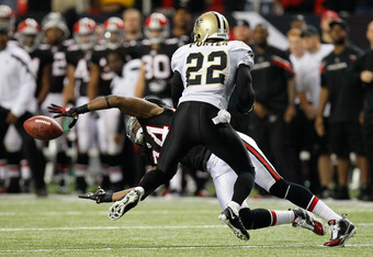 ATLANTA, GA - NOVEMBER 13:  Tracy Porter #22 of the New Orleans Saints is called for pass interference against Roddy White #84 of the Atlanta Falcons at Georgia Dome on November 13, 2011 in Atlanta, Georgia.  (Photo by Kevin C. Cox/Getty Images)