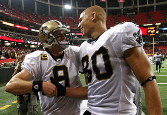 ATLANTA, GA - NOVEMBER 13:  Drew Brees #9 and Jimmy Graham #80 of the New Orleans Saints celebrate after their 26-23 win in overtime against the Atlanta Falcons at Georgia Dome on November 13, 2011 in Atlanta, Georgia.  (Photo by Kevin C. Cox/Getty Images