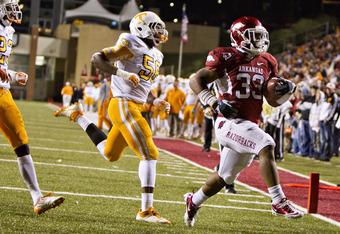 FAYETTEVILLE, AR - NOVEMBER 12:   Dennis Johnson #33 of the Arkansas Razorbacks runs the ball for a touchdown against the Tennessee Volunteers at Donald W. Reynolds Stadium Stadium on November 12, 2011 in Fayetteville, Arkansas.  The Razorbacks defeated t
